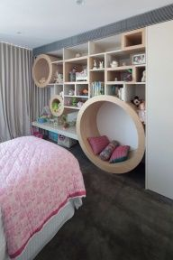 What a novel way to add storage for a bedroom.  The circles add interest, and create perfwct little nooks for storage - and a little bit of R.