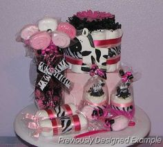 Google Image Result for http://babylovediapercakes.com/Photo_Gallery_-_Baby_Bouquets_-_Corsages_-_Carriages/slides/Pink-Zebra-Baby-Gifts.JPG