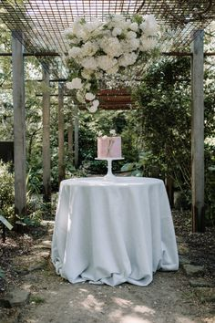 single tier blush cake by Bloosom and Crumb Secret Garden Wedding Shoot Featured on Coco Wedding Venues Wedding Venues Uk, Outdoor Wedding Reception, Tent Wedding, Wedding Signage, Wedding Shoot, Garden Wedding, Wedding Cake, Outdoor Wedding Inspiration, Spring Wedding Inspiration