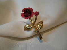 Red rose brooch simular to covann