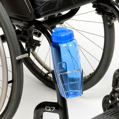 Wheelchair Water Bottle Holder $19.95 Do you want the coolest wheelchair water bottle holder on the planet? Looks cool!  Great design! Manufactured with a stainless steel frame and the  best clamping system on the market today.