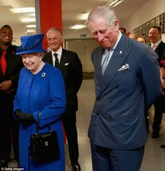 Humour: Charles appears unable to contain his laughter as the Queen and The Prince of Wale...