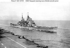 HMS Vanguard comes alongside an unidentified British carrier.