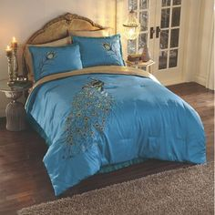 Embroidered Peacock Comforter Set from Midnight Velvet. One of nature's most exquisite creatures gets a worthy portrait embroidered on this comforter set, creating a noteworthy spot for you to nest.