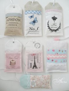 cute tags. Good idea to make a pocket envelope like these to put things in (tickets, etc) from the event
