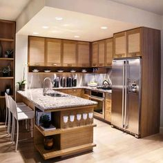 Kitchen. brown wooden cabinet and kitchen island with shelves and gray counter top combined with silver steel fridge placed on the brown wooden flooring . Astounding Modern Kitchen Designs For Small Spaces Give Nice Look