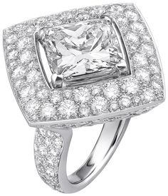 """""""Signature Ultime"""" rings n 18K white gold set withdiamonds. """"Signature de  Chanel"""" Collection - """"Signature Ultime"""" ring in18K white gold set witha 6–carat cushion–cut diamond and 195 brilliant–cut diamonds for atotal weight of4.5 carats"""