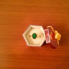 Reduced*Beautiful Costume emerald ring Costume jewelry; green stone surrounded by czs; size 9; gold plated but gorgeous - much prettier than photo; new never worn; ring is not adjustable Jewelry Rings