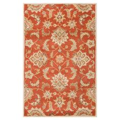 Anchor your living room seating group or dining table in classic style with this elegant wool rug, featuring a floral motif in orange rust and gray.