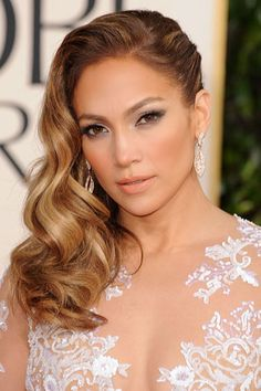 Jennifer Lopez has a talent for nailing almost every look on the red carpet! We've decided to pin this one to our wedding look inspiration board -- this romantic side swept look can be achieved with both our wavy or natural straight (curled wig a wand) hair collections! www.elitehairboutique.net