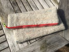Hand made clutch pouch using woven handspun yarn.