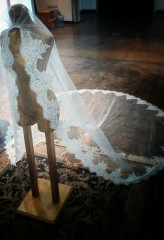 Beautiful unique hand beaded eyelash lace veil. This is the perfect veil if you are looking to make a statement.  Cathedral Length Sequins,