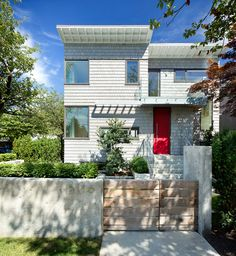 13 Examples Of Modern Houses With Wooden Shingles // This corner house in Vancouver, covered in light grey shingles.