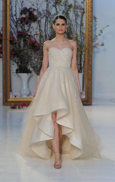 Champagne high-low gown with beading embellishments | Anne Barge Spring 2017 | https://www.theknot.com/content/anne-barge-wedding-dresses-bridal-fashion-week-spring-2017