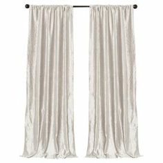"""Faux velvet curtain panel in snow white.  Product: Set of 2 curtain panelsConstruction Material: 100% PolyesterColor: White Features:  No lining3"""" Rod pocket Dimensions: 84"""" H x 40"""" W eachCleaning and Care: Dry clean"""