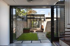 A small grassy area separates two different spaces in this home.