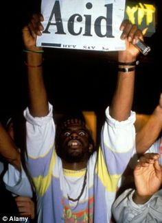 A raver holds up a banner at Trip nightclub in London, one of the first acid house clubs in the UK when it opened in June 1988