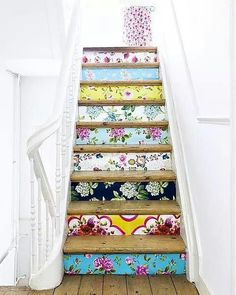 Stairs like that ♥ [buy cheap wood slats, wallpaper samples glued on, afix to stairs so they are removable]