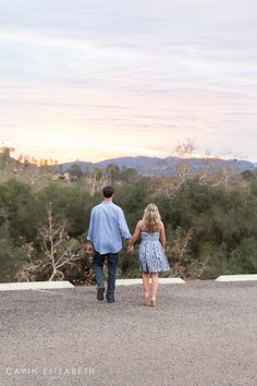 Engagement Photography Session in San Diego during sunset, beautiful Southern California sunset, couple walking off holding hands, Cavin Elizabeth Photography