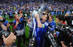 Pure delight: Frank Lampard kisses old big ears