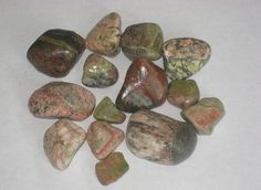 "Unikite or better known as hamburger stones. Great Lakes. Unakite, also called epidote, derives its name from the Greek epidosis, meaning ""growing together"". It is a combination of red jasper and green epidote solidly bound together."
