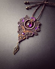 Knotted mystical macrame pendant with a beautiful amethyst inside and brass beads. Now available in our #etsyshop #etsy #etsylove…