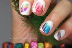 Colourful feather nails.