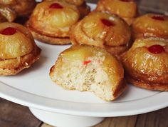Pineapple Upside Down Cupcake.  This was my first time making any form of Pineapple upside down cakes.  What got me was the whiskey.  How can you go wrong, with whiskey involved!    Using a cutting board while they cool in the cupcake tin was the best idea ever!!  Even my husband who has no sweet tooth whatsoever - gobbled these cakes up!