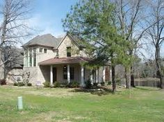 Love the old house with the shaded porch