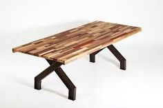 The top of this table has been stuck together with the crisps in the middle to make it strong. This table is made up of many different slice/pieces of wood. This is an permanent connection