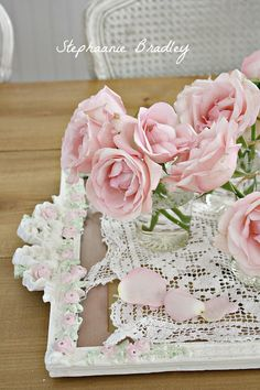 Pink roses, barbola roses, and vintage lace. On a painted mirror frame