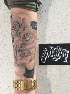 Women's forearm rose tattoo