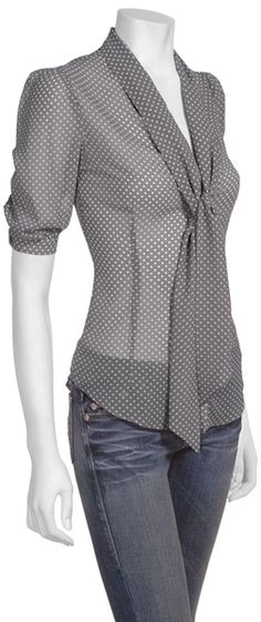 Grey polka dot blouse.