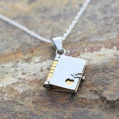 Book necklace - it opens up to display three turnable golden pages!