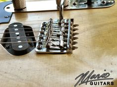 Mario Guitars Blackguard Tele... like the cuts emulating the screws as if they are grinding into the body