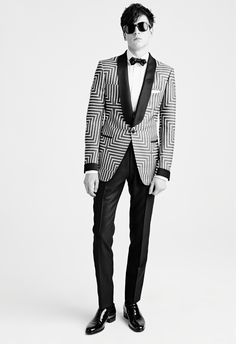 MEN'S AW15 LOOK 29   Black and white bold geometric squares gros grain shawl collar buckley cocktail jacket. White poplin classic collar piquet plastron evening shirt with concealed buttons. Black overdyed mélange mohair satin trim buckley evening pants with belt loops. White cotton pocket square. Black silk small evening bow tie. Black Campbell sunglasses. Black patent bulwer high vamp elasticated side loafer.