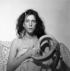 Patti Smith, by Robert Mapplethorpe. Patti Smith sits for her portrait in a bed sheet. Patti Smith Songs, High Society, Patti Smith Robert Mapplethorpe, Robert Mapplethorpe Photography, Musica Punk, Just Kids, Chrysler Museum, Musée Rodin, Tv Movie