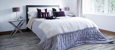 If you're looking for a quick way to save energy costs while you sleep, try a thicker comforter for your bed and avoid touching the thermostat. How long will you go before turning up the heat? French Grey, French Country, Grey Bed Covers, Grey Laminate Flooring, Purple Pillows, Grey Bedding, Comforter, Steam Cleaning, Country Estate