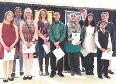 POSITIVE WINNERS — These 10 contestants recently competed in an Optimist Club contest. Winners Katlyn Kaza and Marwa Tahboub are pictured at third and sixth from the left, respectively.  Photo provided