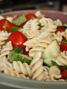 cucumber and tomato pasta salad with feta cheese and Olive Garden dressing soooo good