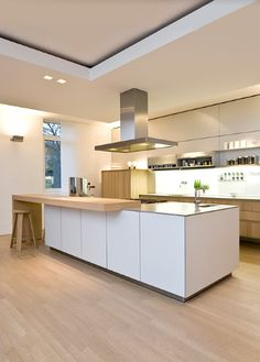 White lacquer cabinet uppers & wood lowers // wood floors // floated ceiling