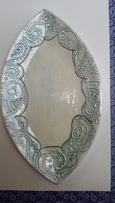 Carved and slippainted platter by Susan Loubser