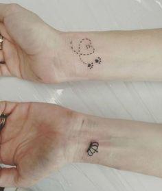 Heart path paw prints tattoo