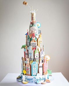 The finished piece! A chocolate cake with 5 layers of filling and vanilla biscuit booze bottle detail! Thank you for all the comments and likes thus far everyone! #handpainted #luxury #instacake #bottles #jewel #multicoloured #event #london #celebration #birthday #sugarcraft #alcohol #cookies #cookie #vanilla #50 #hendricks #cointreau #absolut #champagne #cocktails #birthdaycake #bombaysapphire #bollinger #vodka #celebrationcake