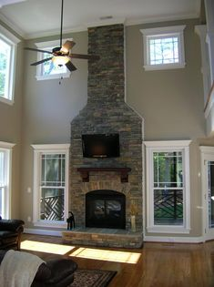 2 Story Stone Fireplace by Royalty Homes, Inc.