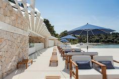 The Mulini Beach Bar, situated at the Mulini Beach, in a bay below the Lone and Monte Mulini hotels in Rovinj, Croatia