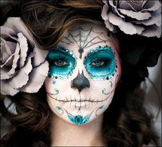 dia de los muertos face paint... has awesome bling aroud her eyes! :o)