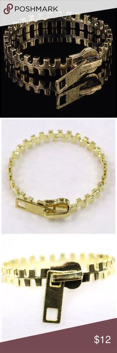 """D29 Gold Metal Zipper Bangle Bracelet ‼️ PRICE FIRM UNLESS BUNDLED WITH OTHER ITEMS FROM MY CLOSET ‼️   Retail $24  Super fun zipper bracelet.  Made of sturdy metal.  Bangle. Approximately 8.8"""" around.  Please check my closet for many more items including designer clothing, shoes, handbags, scarves & much more!! Jewelry Bracelets"""