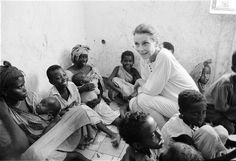 UNICEF Goodwill Ambassador Audrey Hepburn greets children and women after witnessing the impact of famine on Somalia's children in 1992
