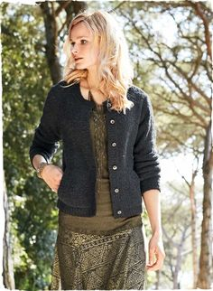 The frothy cardigan is knit in bouclé yarns of alpaca (89%) and nylon (11%). Patch pockets.